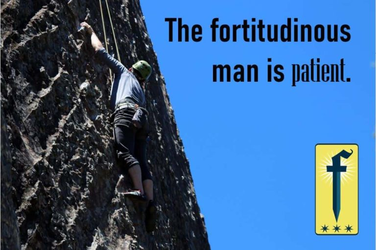 A Man climbing up a wall