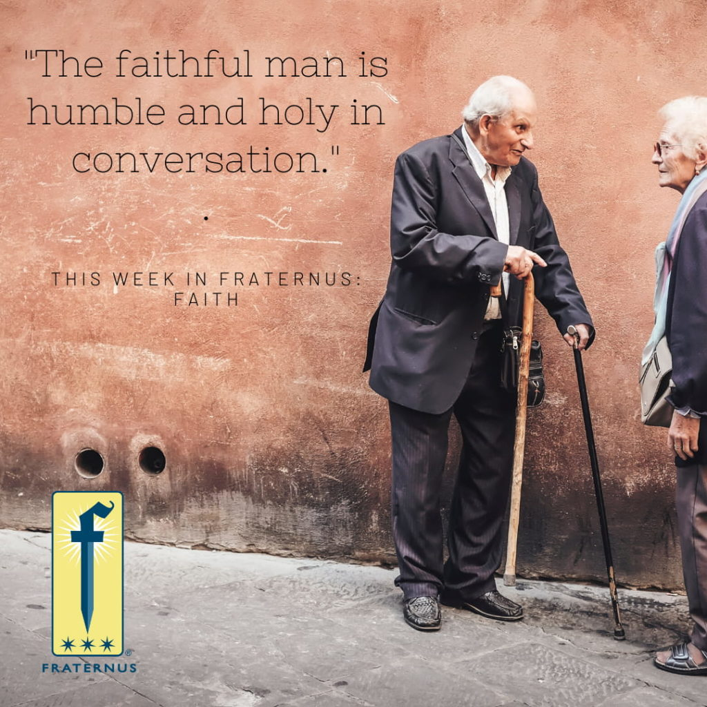 Two swtanding men speaking to each other